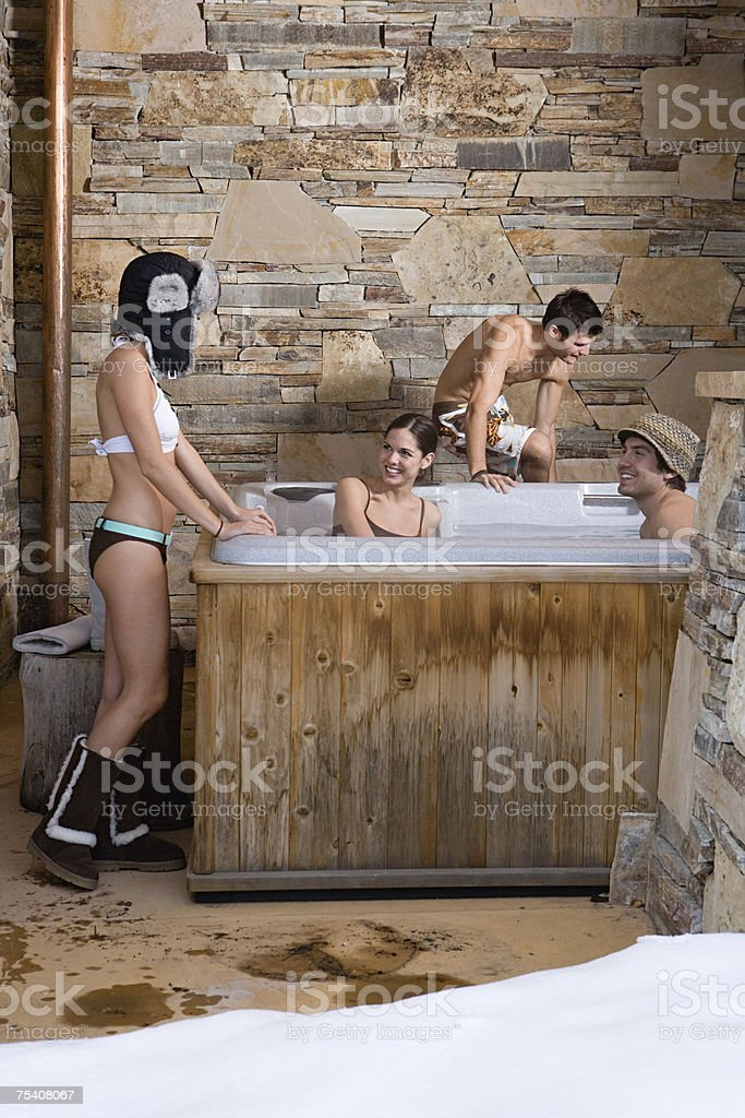 Young people in a hot tub stock photo