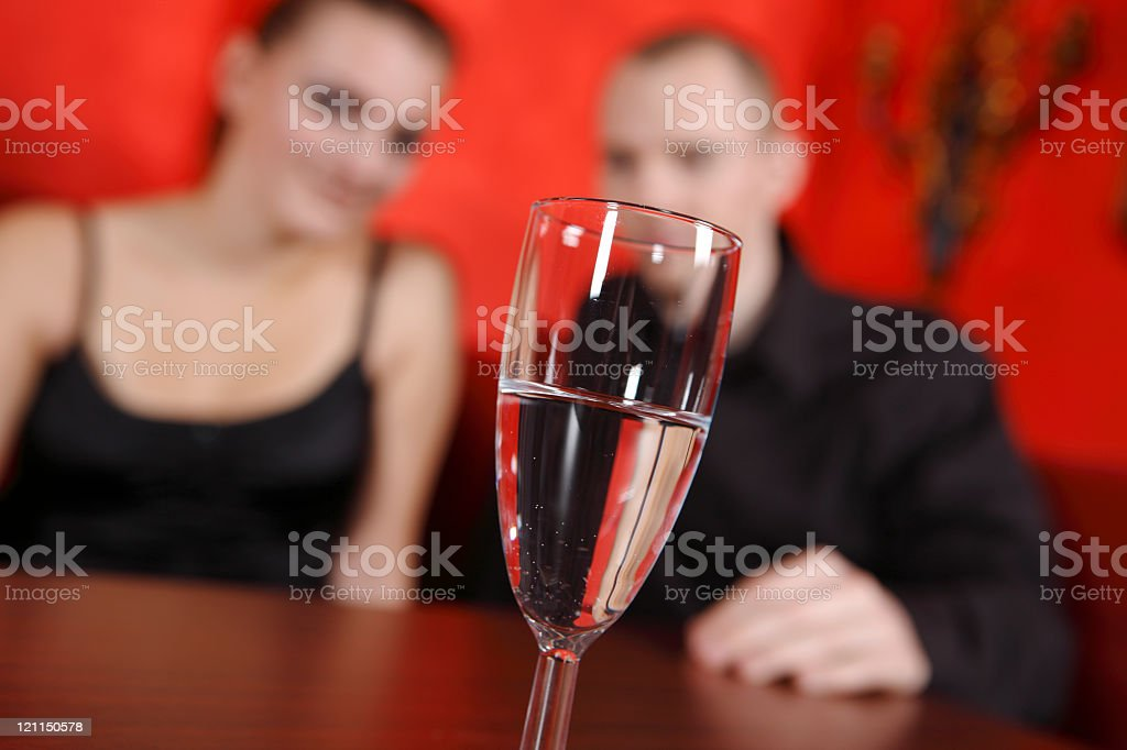 Young people in a nightclub with glass stock photo