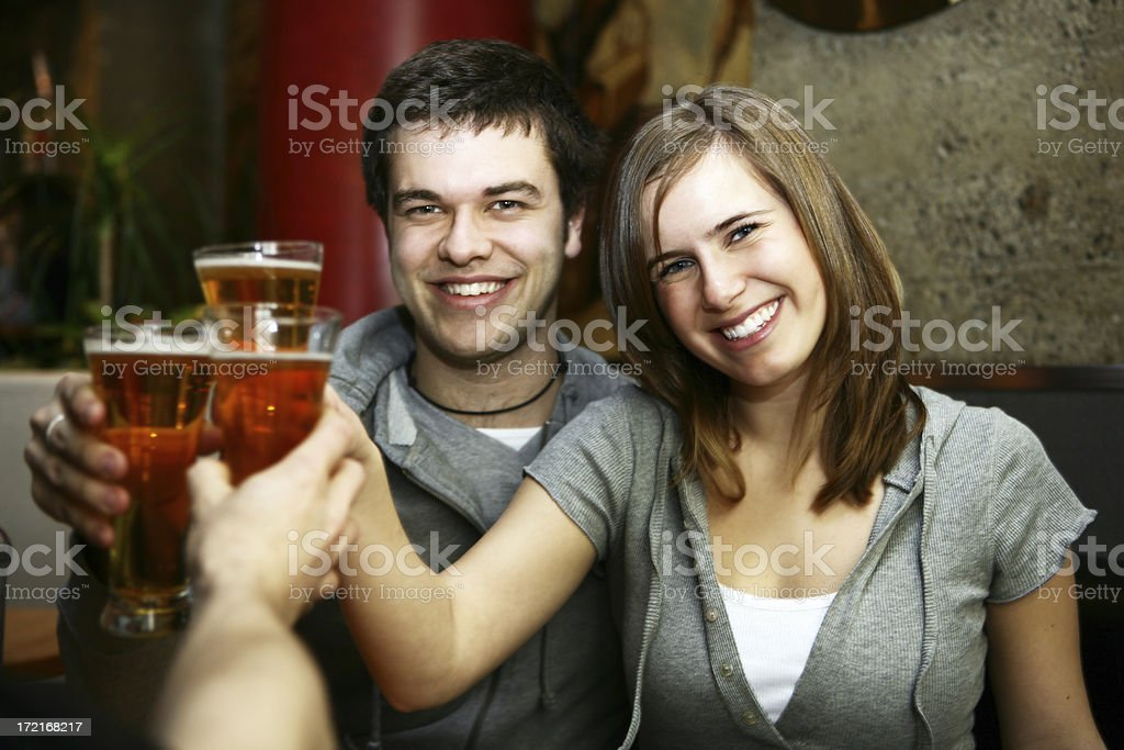Young people in bar royalty-free stock photo