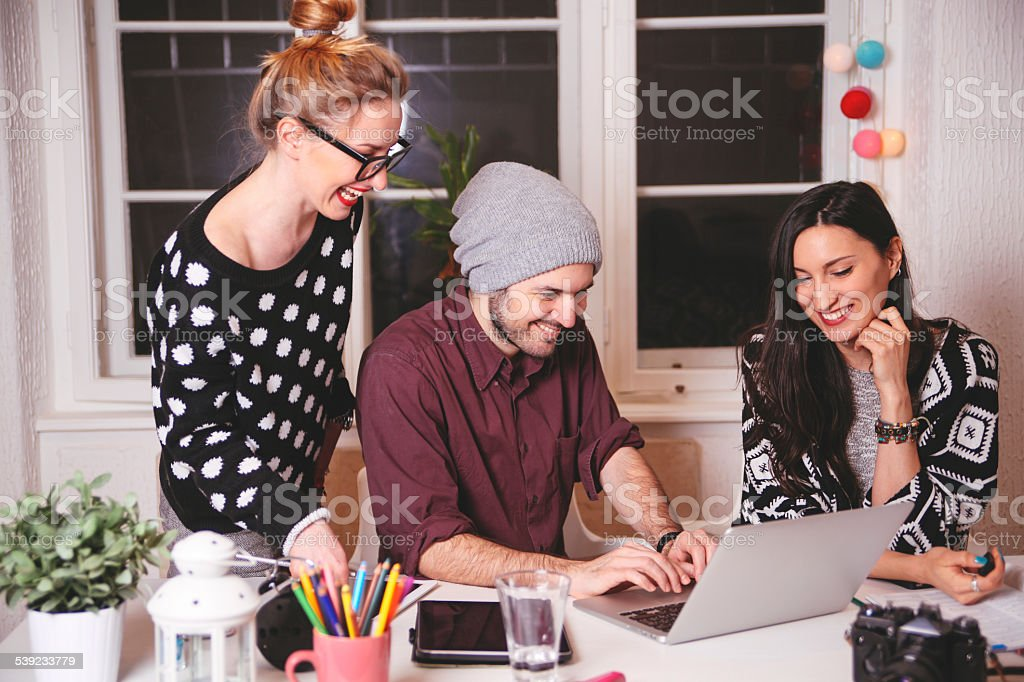 young people in creative designer office space stock photo