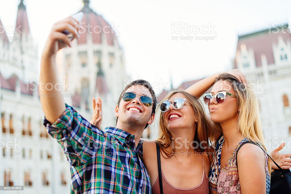 Young people in European city taking selfie stock photo