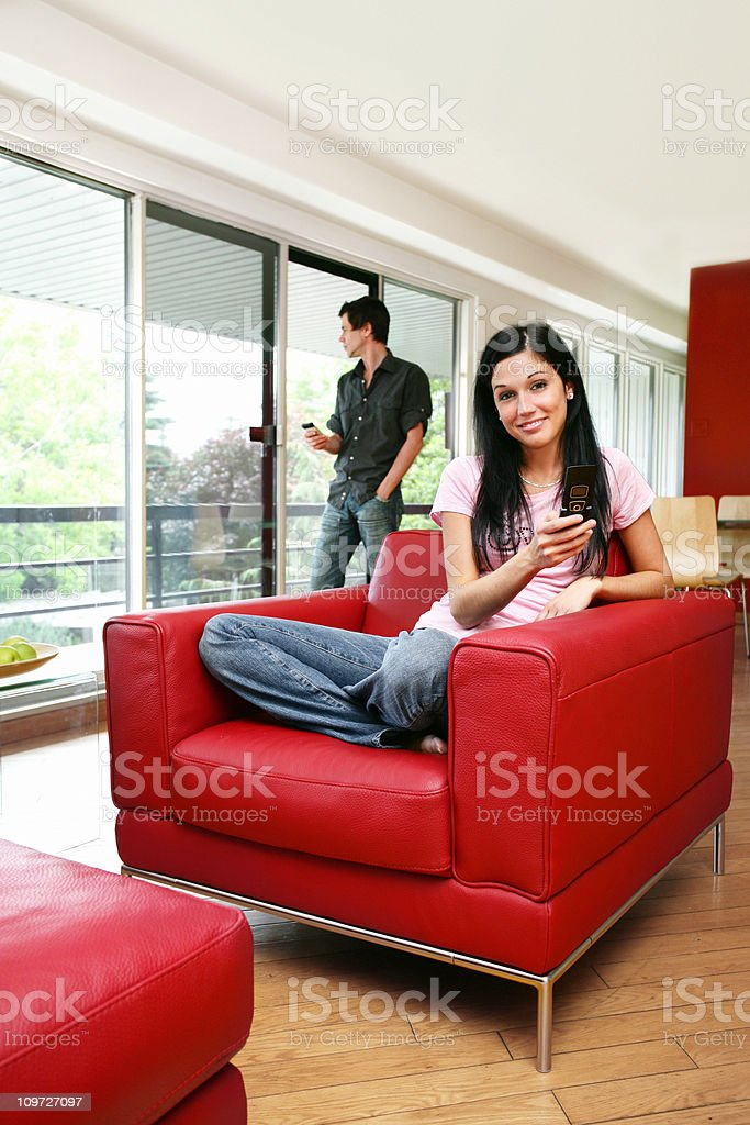Young people in livingroom royalty-free stock photo