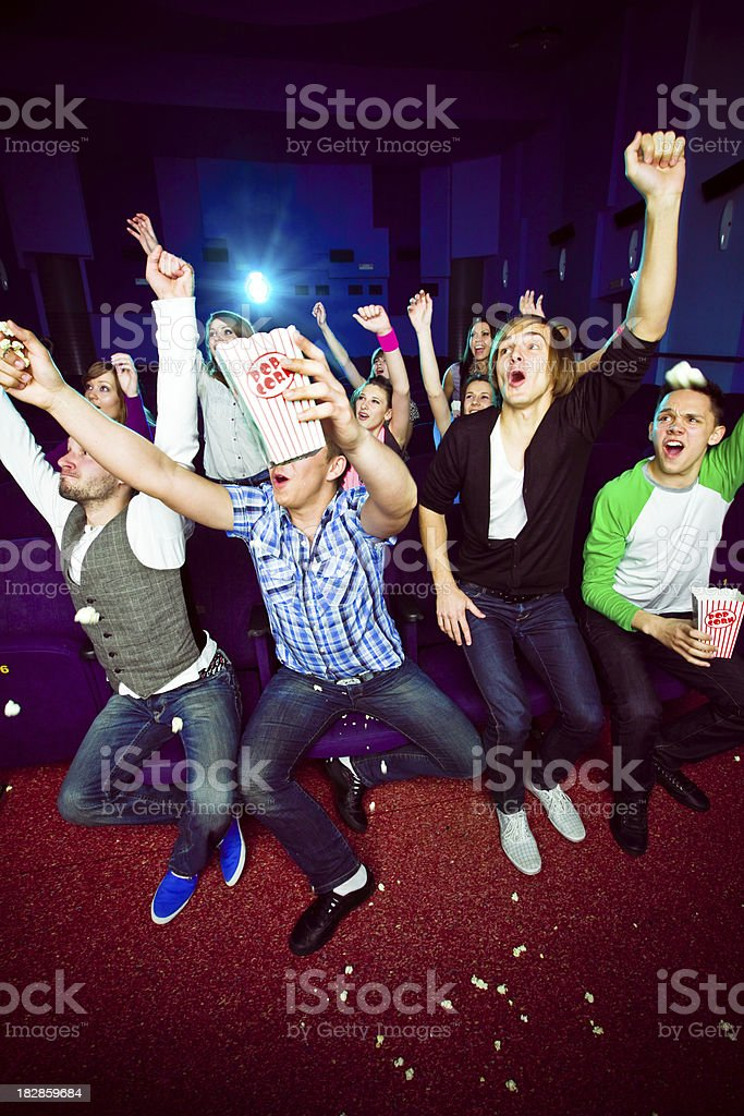 Young people in move theater royalty-free stock photo