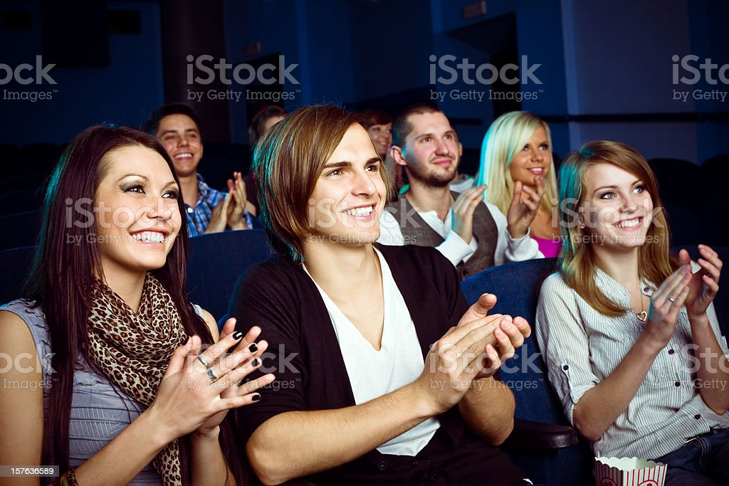 Young people in movie theater stock photo