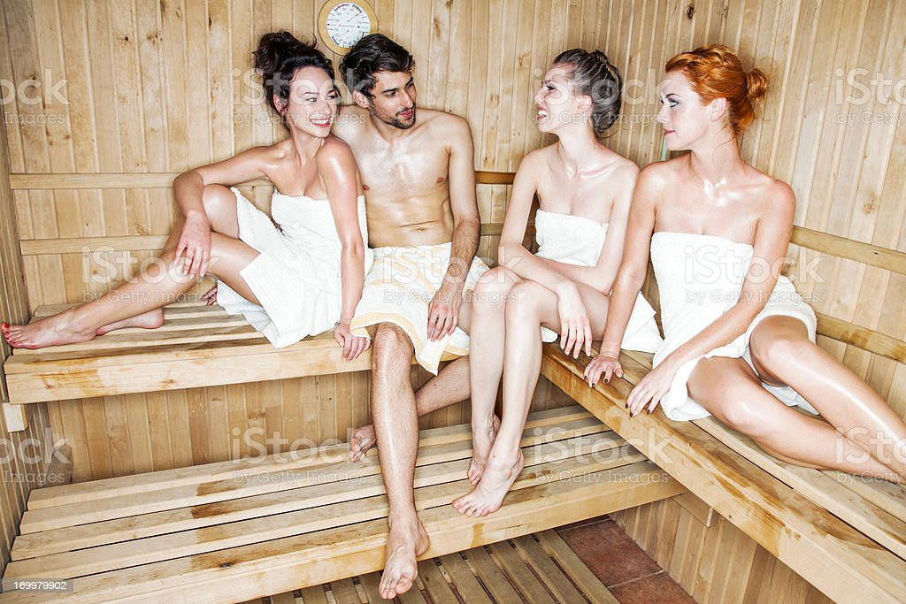Young people in sauna royalty-free stock photo