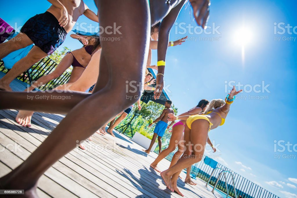 Young people in swimwear dancing stock photo