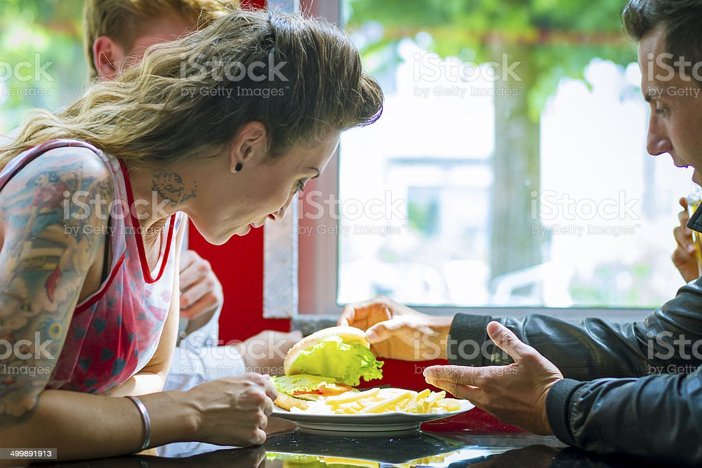Young people in vintage Fast Food - 1950's style stock photo