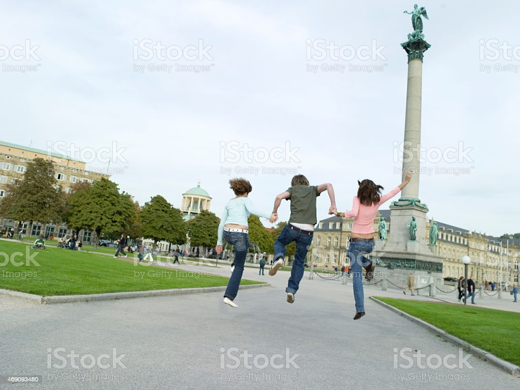 Young people jumping, hand in hand stock photo