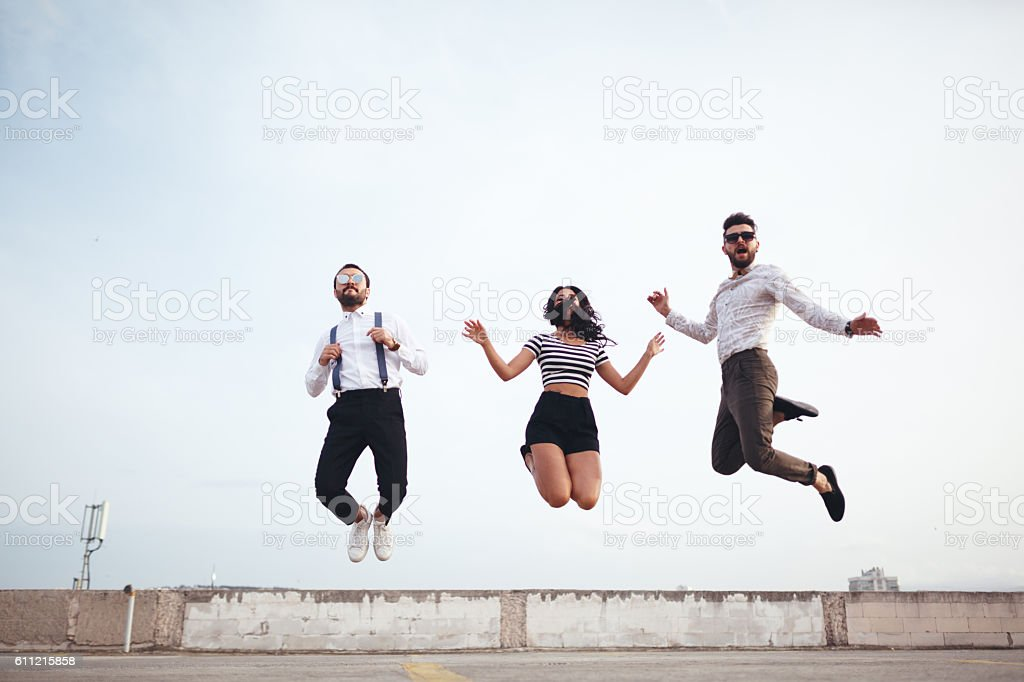 Young people jumping stock photo
