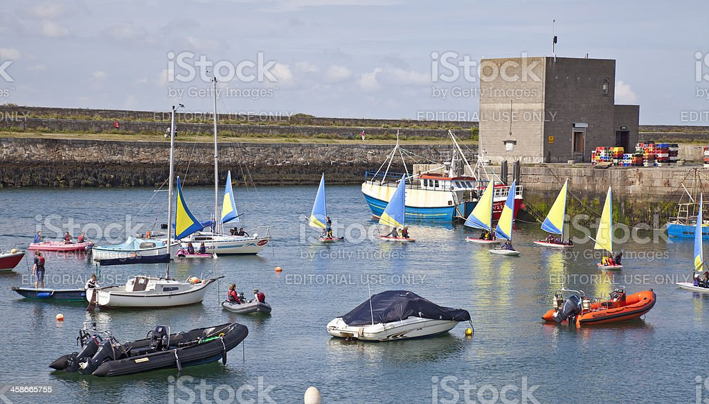 Young people learning to sail in Dun Laoghaire harbour stock photo