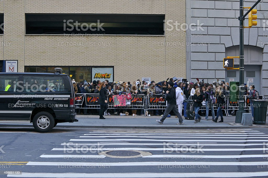 Young people lined up for radio station event, NYC stock photo