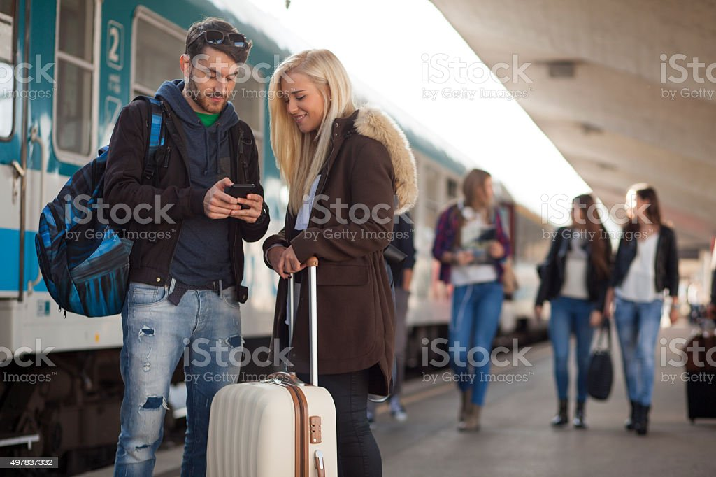 Young people on train station stock photo