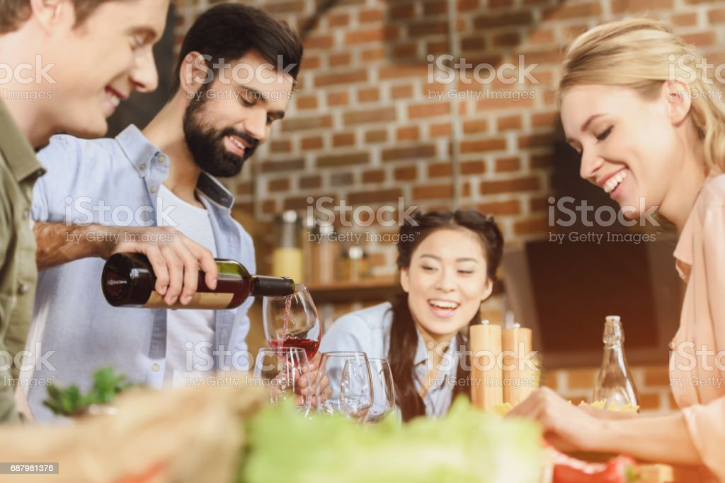 young people partying at kitchen stock photo