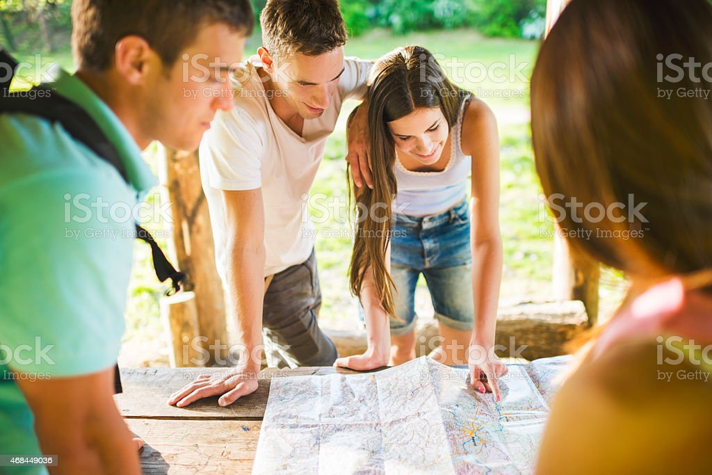 Young people planning a route. stock photo