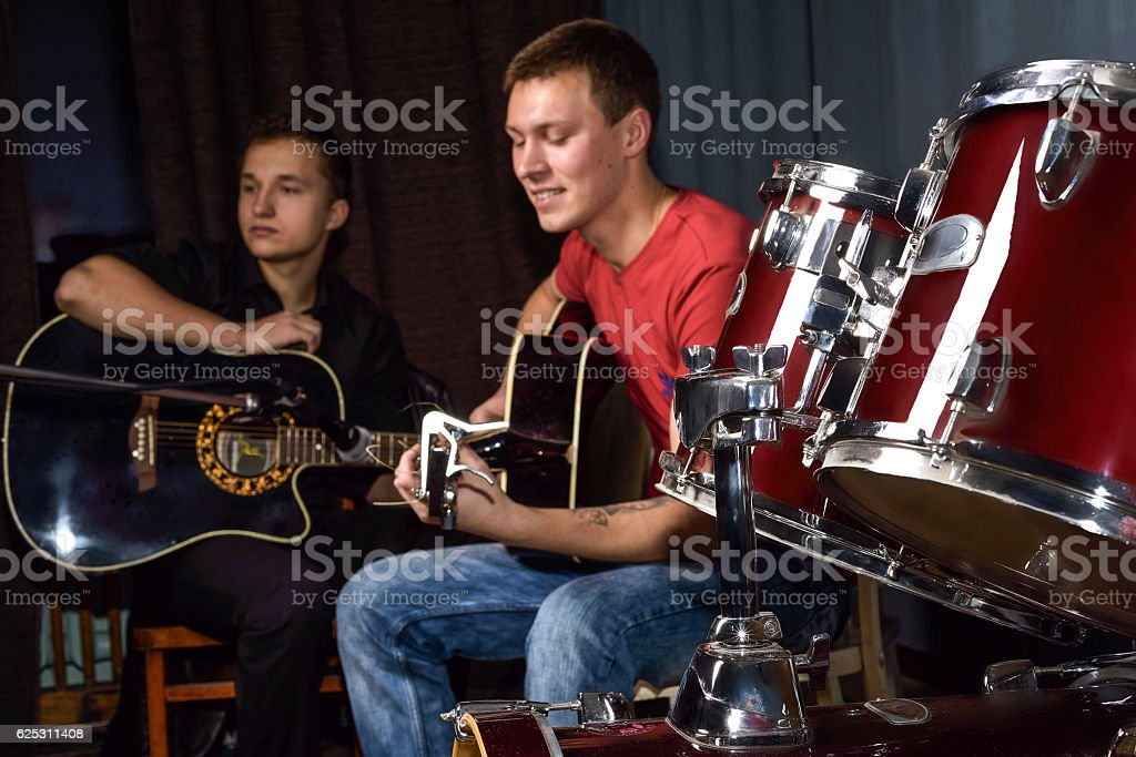 young people playing guitars stock photo