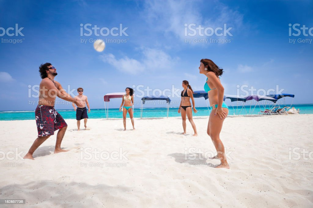 Young people playing Voleyball on a beach stock photo