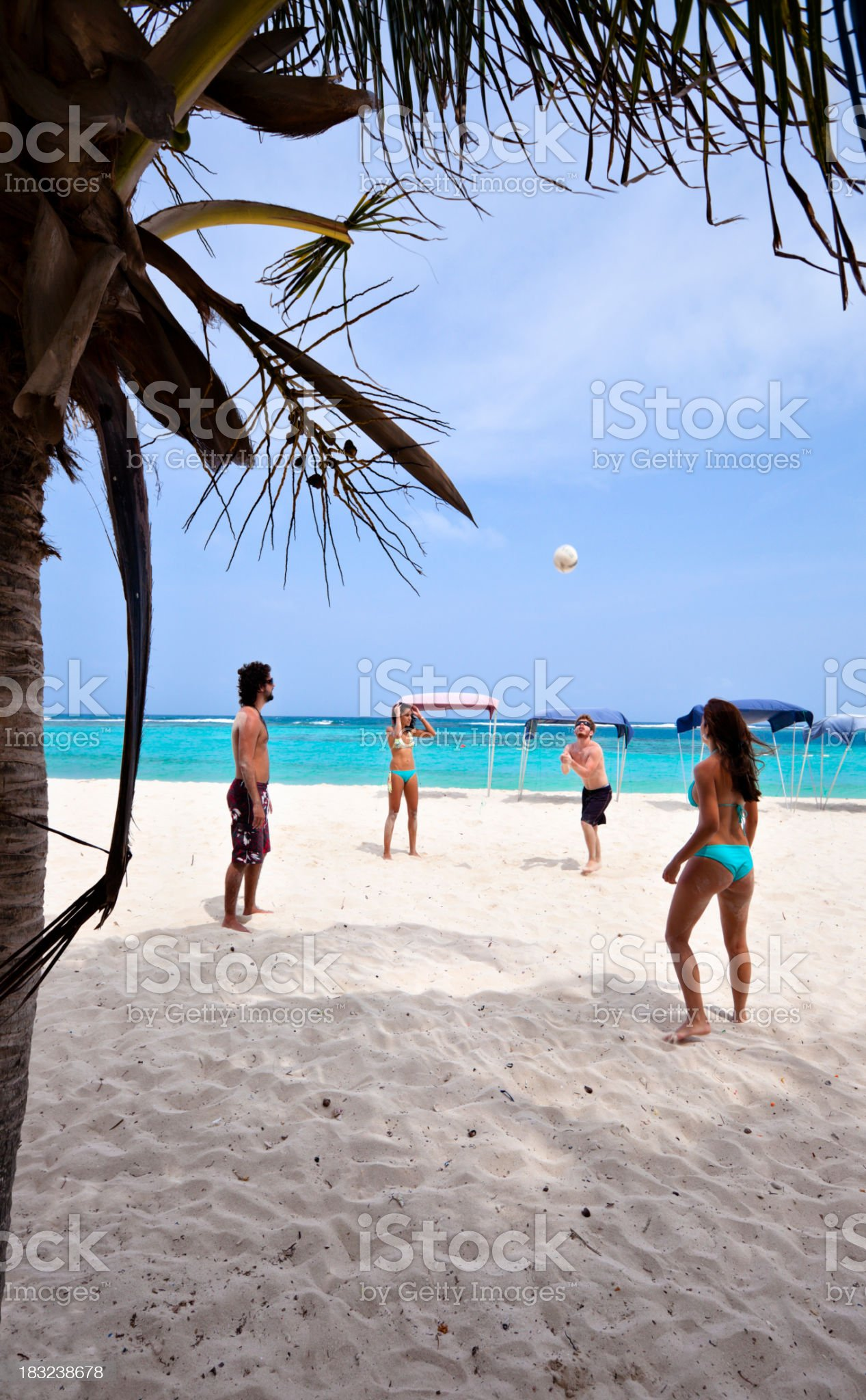 Young people playing Voleyball on a beach royalty-free stock photo