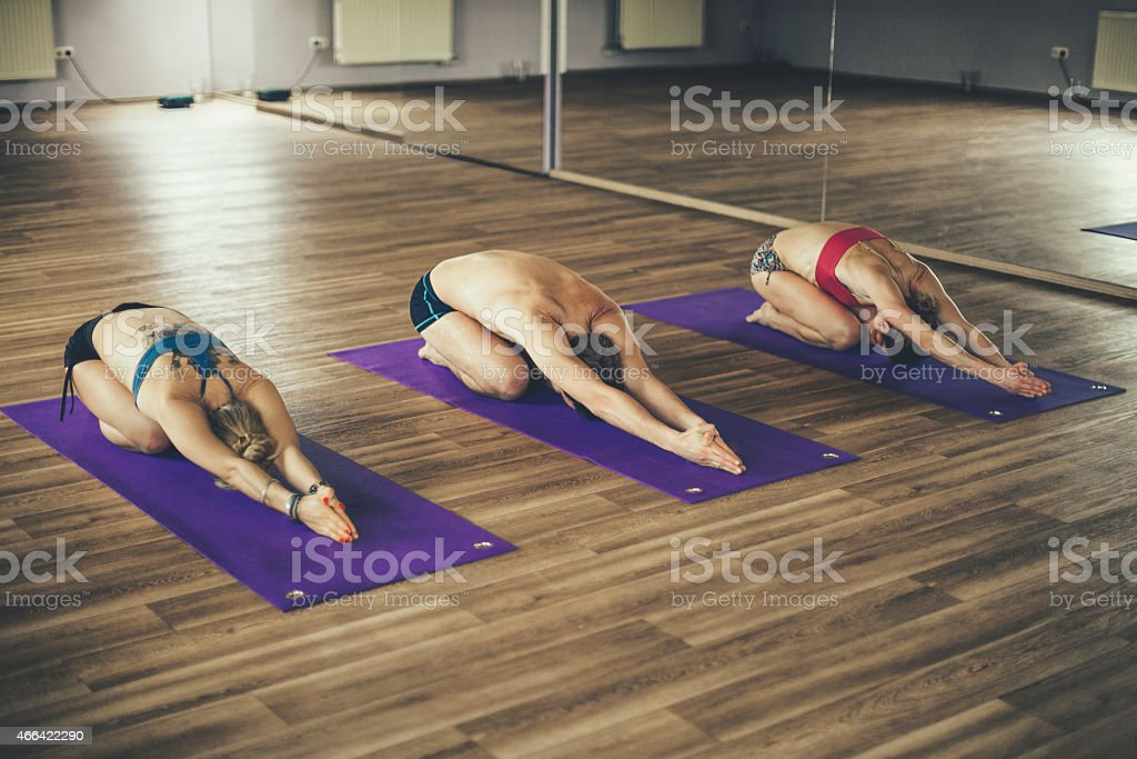 Young people practicing bikram yoga together stock photo