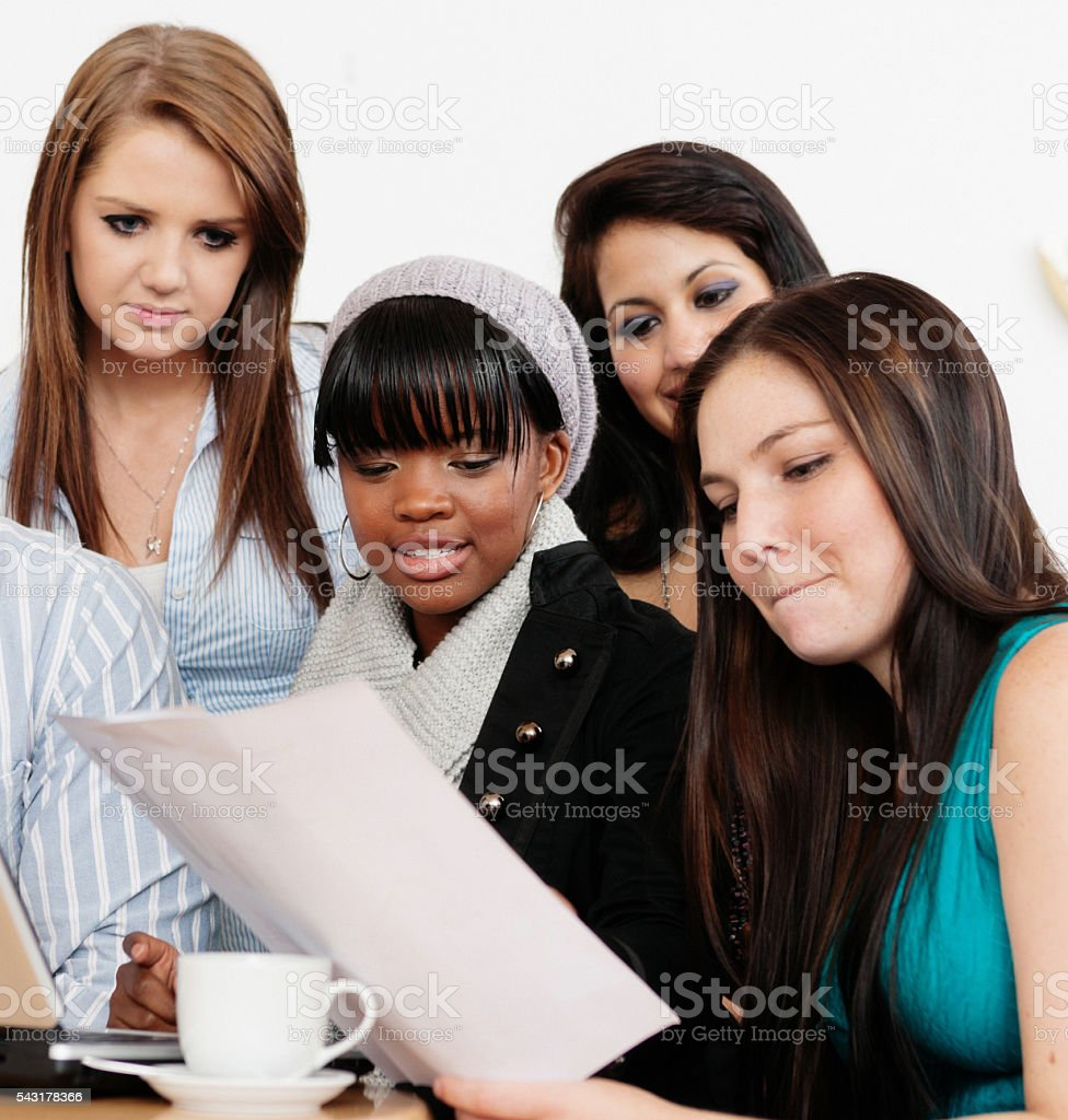Young people react individually to a document, perhaps test results stock photo