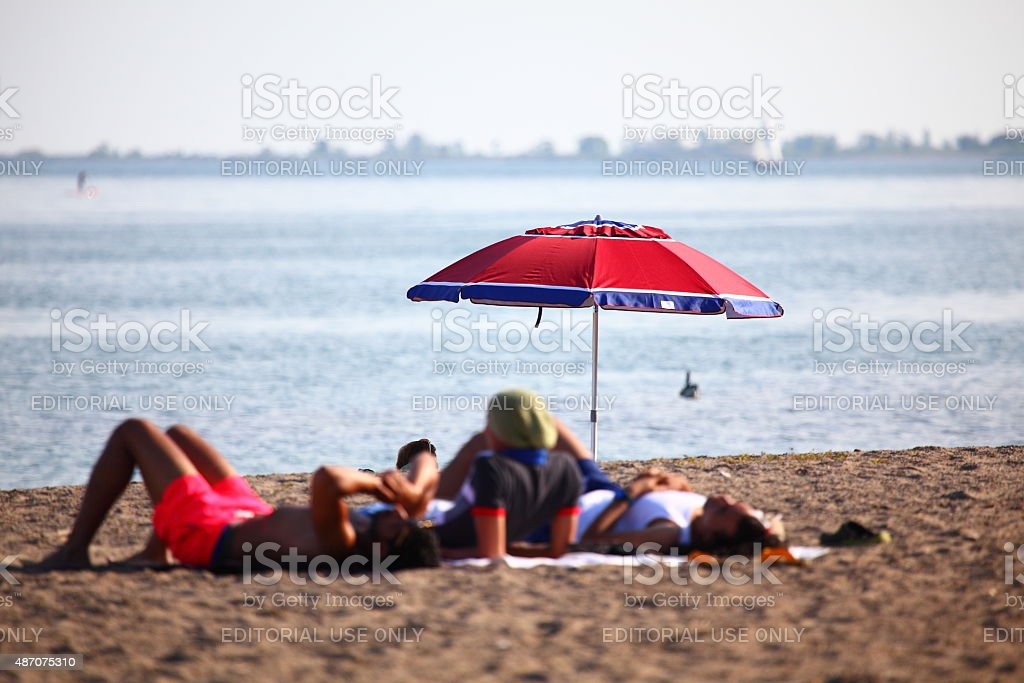 Young people relaxing by the lake stock photo