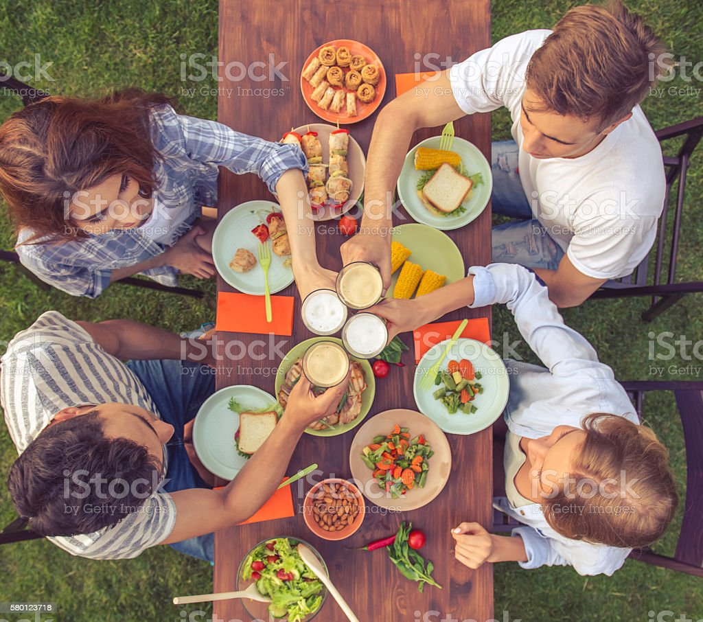 Young people resting outdoors stock photo
