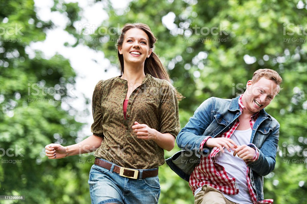 Young people running and having fun royalty-free stock photo