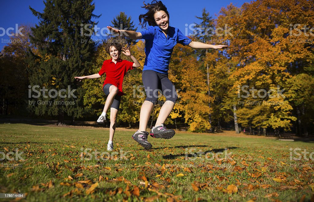 Young people running, jumping outdoor royalty-free stock photo