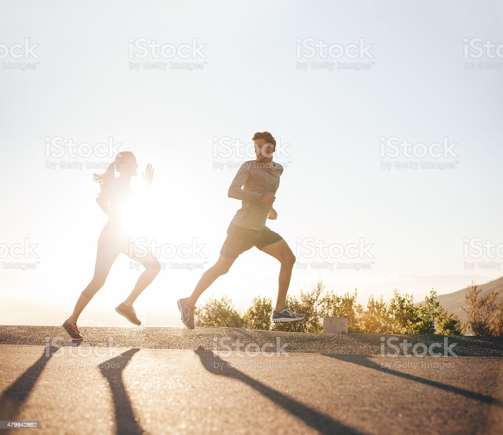Young people running on country road stock photo