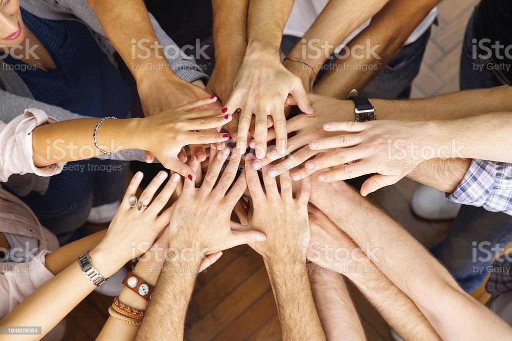 young people showing unity stock photo