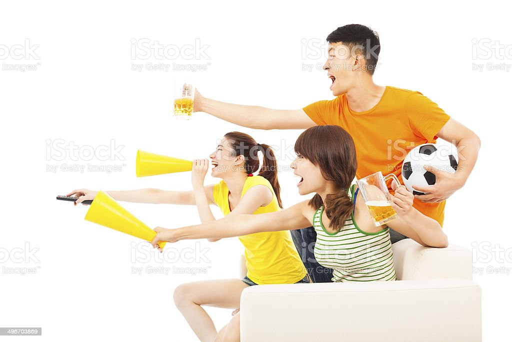 young people so excited to yelling and while watching soccer game...