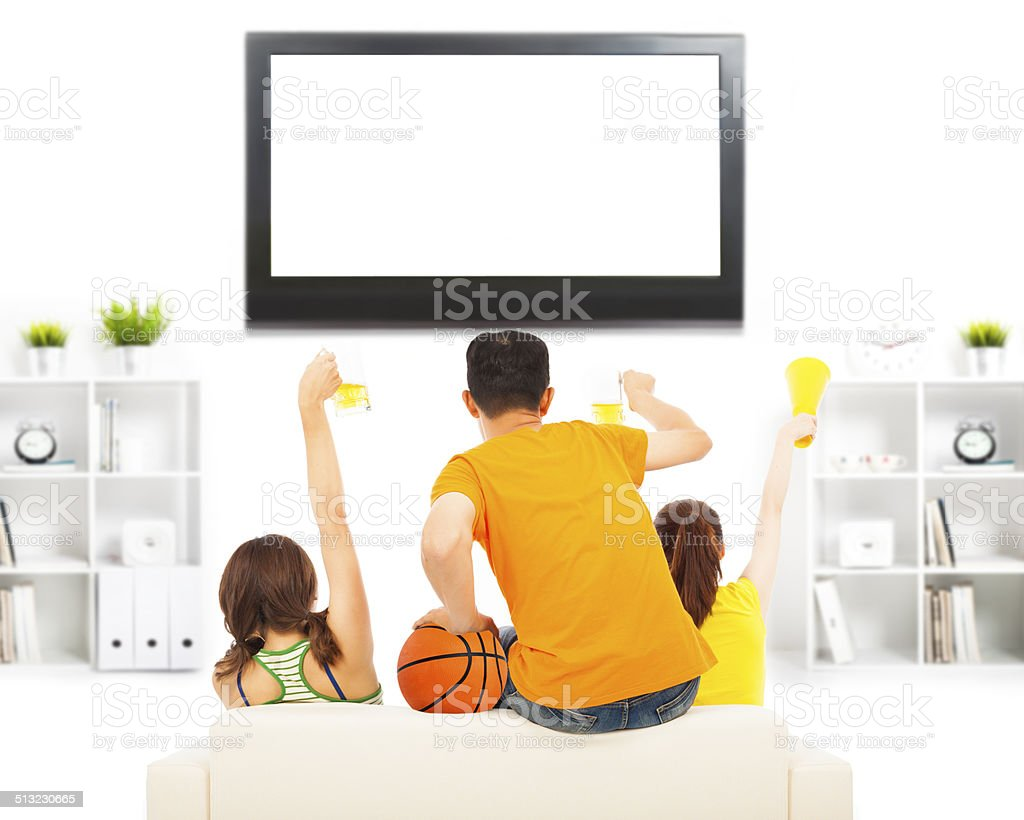 young people so excited to yelling and while watching tv stock photo
