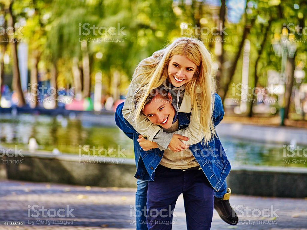 young people spend time outdoors in autumn park. stock photo