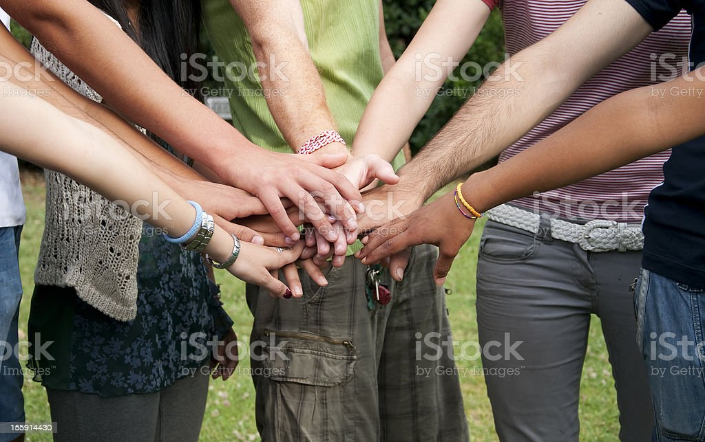 Young People Stack Hands outdoor stock photo