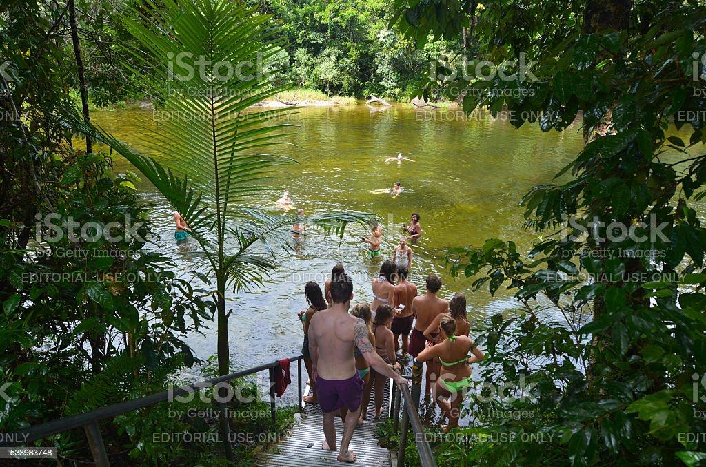 Young people swim in Babinda Boulders in Queensland Australia stock photo
