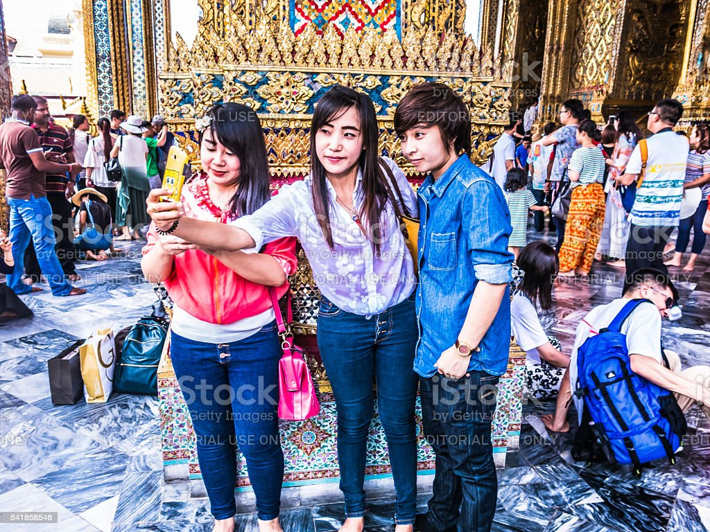 Young People taking Selfies, Grand Palace, Bangkok, Thailand stock photo
