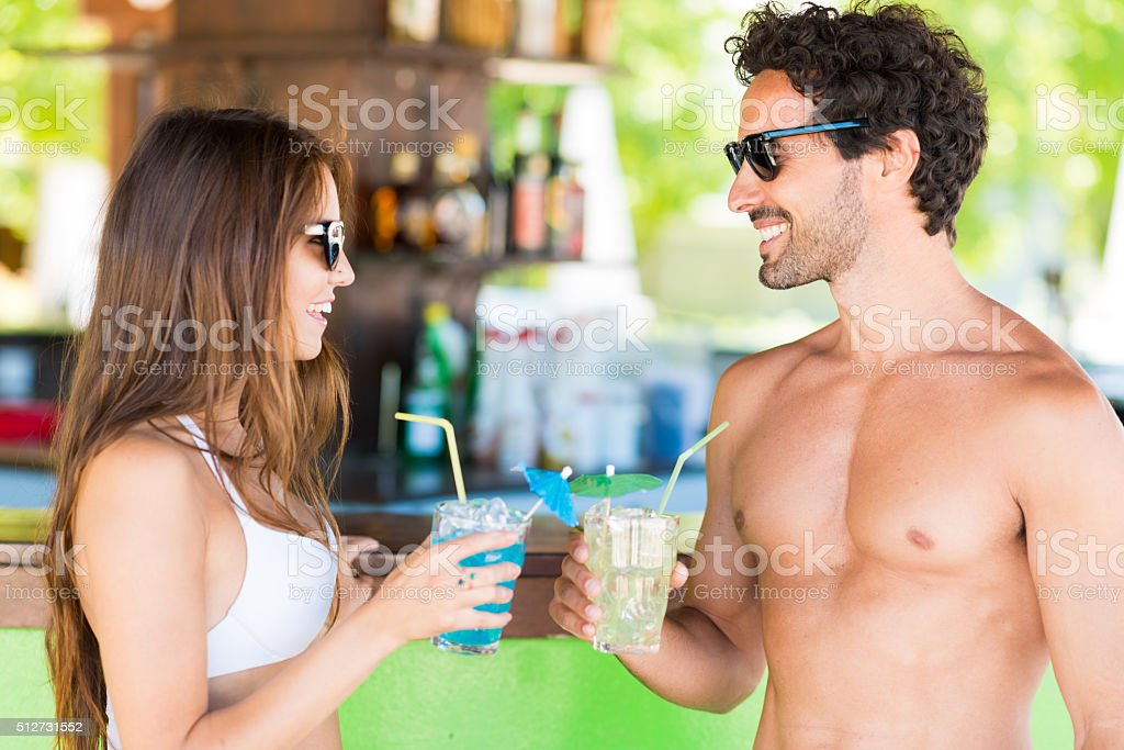 Young people talking in a beach bar stock photo