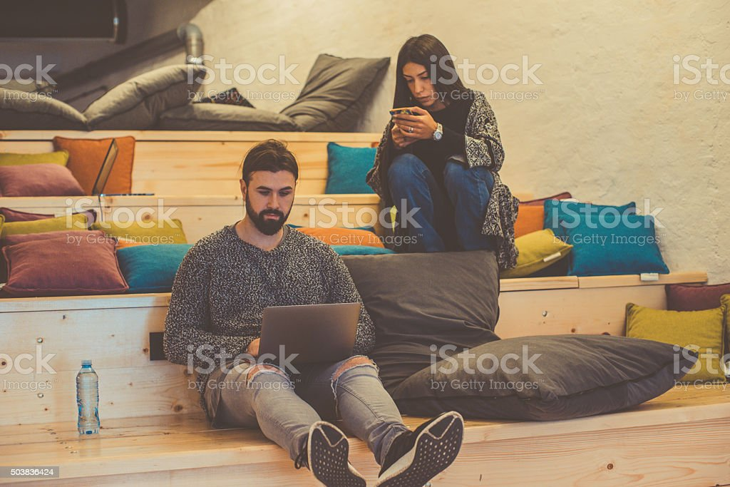young people using laptop stock photo