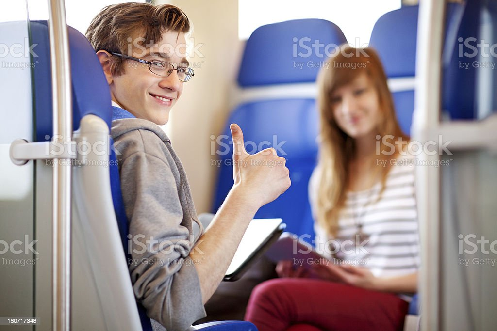 young people using technology at the train stock photo