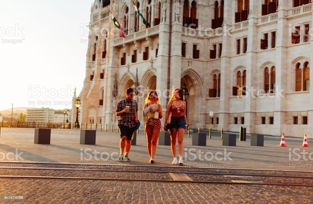 Young people visiting landmarks in European city stock photo