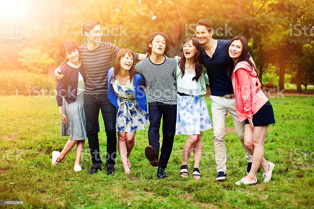 Young people walking in park in Tokyo. stock photo