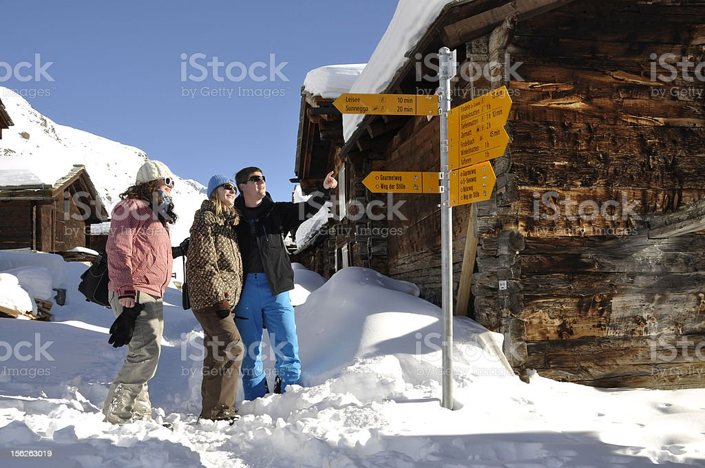 Young people walking in the snow royalty-free stock photo