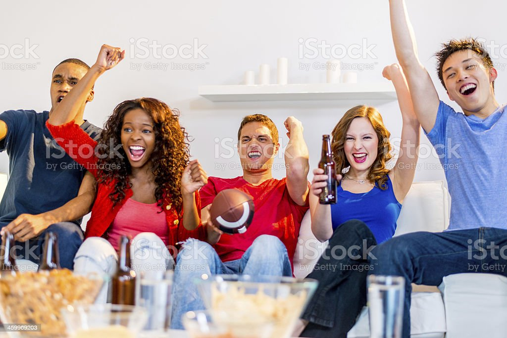 Young people watching football game stock photo