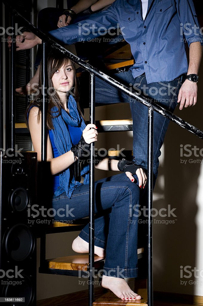 Young People Wearing Jeans On The Stairs stock photo
