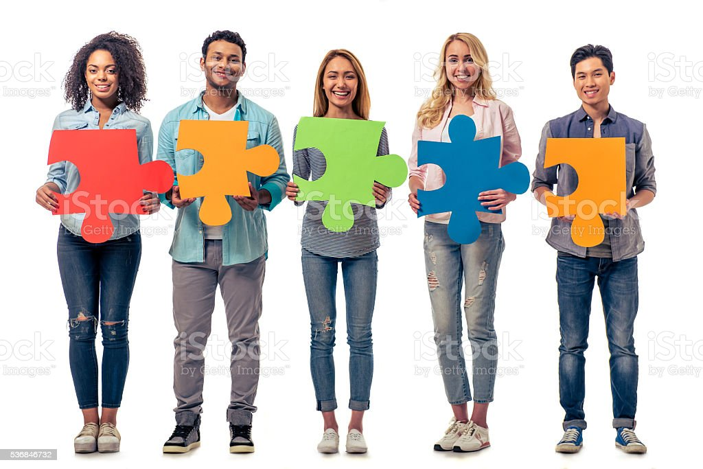 Young people with puzzles stock photo