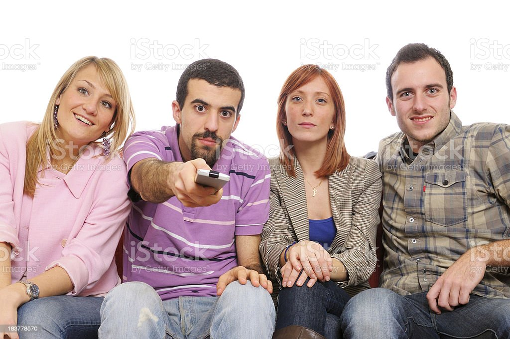 Young People with Remote Control Watching TV.Copy Space royalty-free stock photo