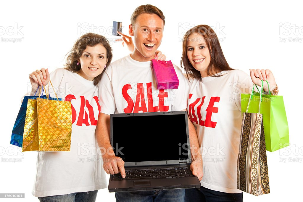 young people with 'sale' t-shirts and laptop stock photo
