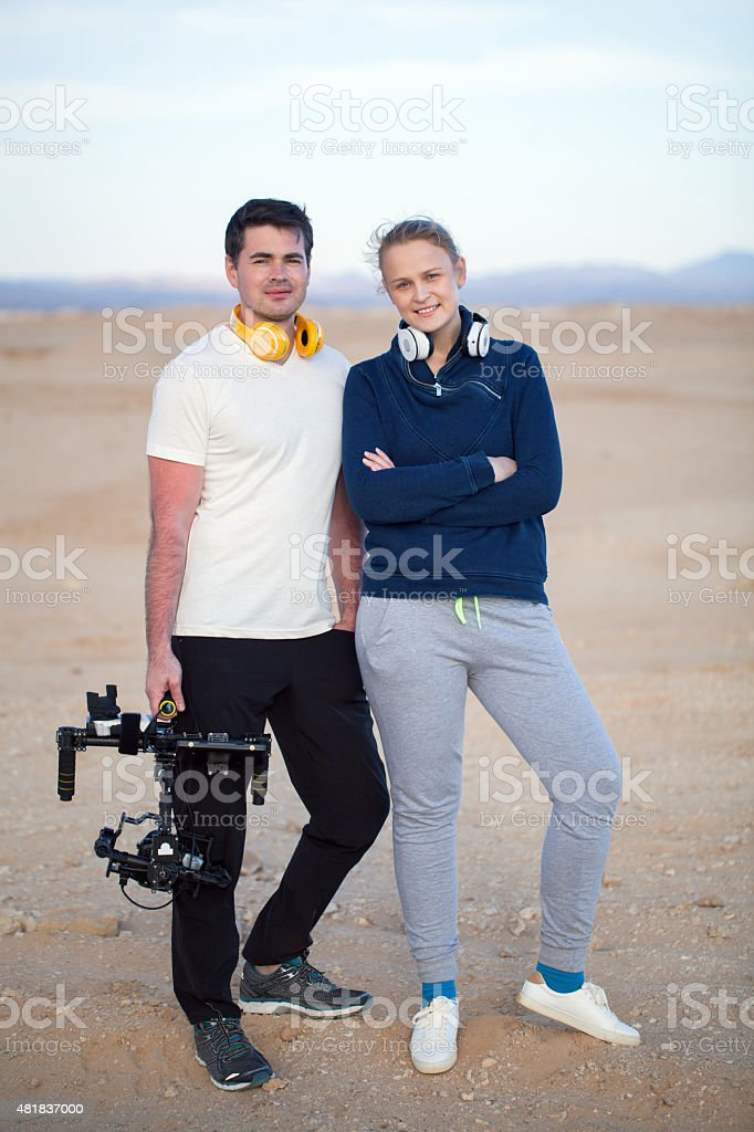 Young people with steadycam on the beach stock photo