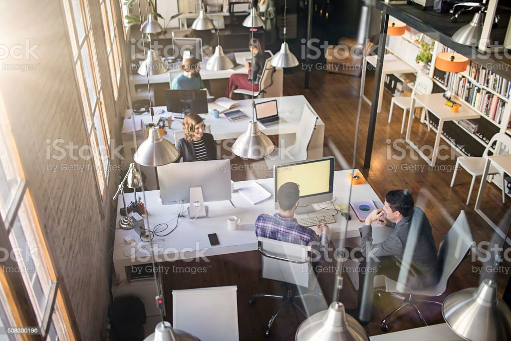 Young people working on a startup office stock photo