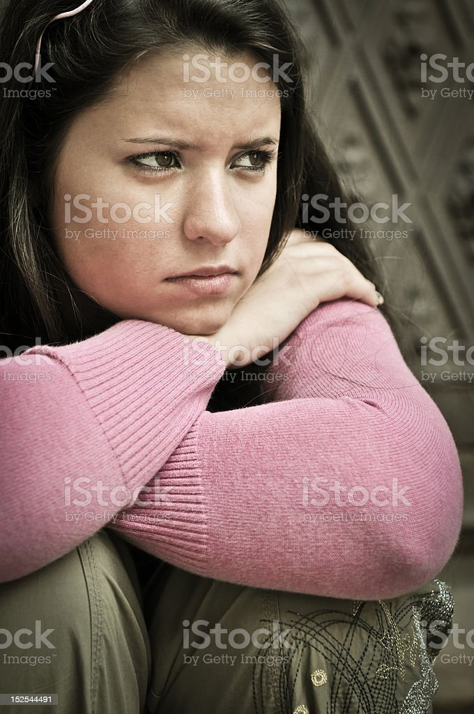 Young person in depression outdoors royalty-free stock photo