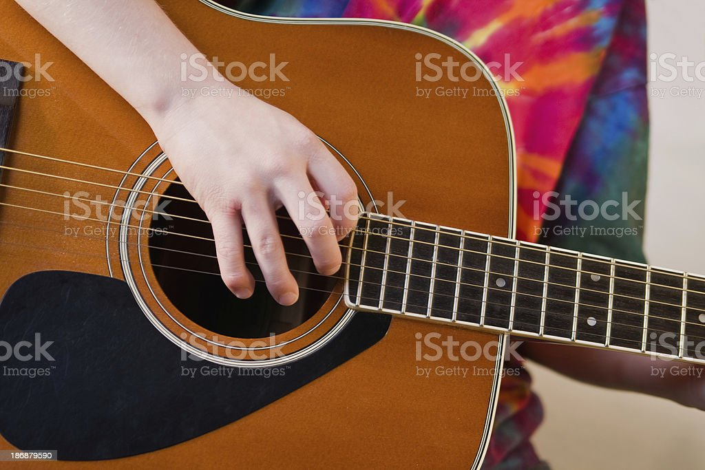 Young Person Playing Guitar stock photo
